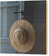 A Sun Hat Hangs On The Door Of A Tuscan Wood Print