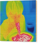 A Thermogram Of A Boy Eating Hot Wood Print