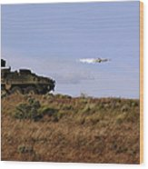 A Tow Missile Is Launched From An Wood Print