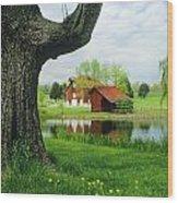 A Tree Frames A View Of A Farm Wood Print by Annie Griffiths