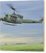 A Uh-1n Huey Helicopter Prepares Wood Print