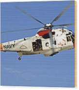 A Uh-3h Sea King Helicopter Flies Wood Print
