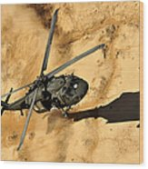 A Uh-60 Black Hawk Helicopter Comes Wood Print