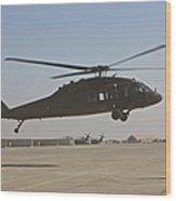 A Uh-60 Black Hawk Landing Wood Print