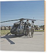 A Uh-60l Blackhawk Parked On Its Pad Wood Print