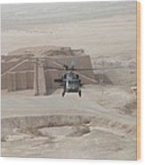 A Us Army Black Hawk Helicopter Hovers Wood Print