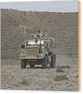 A U.s. Army Cougar Patrols A Wadi Wood Print