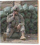 A U.s. Army Soldier Talks On A Radio Wood Print