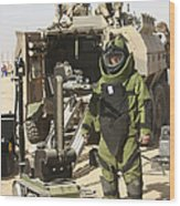 A U.s. Marine Dressed In A Bomb Suit Wood Print