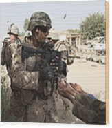 A U.s. Marine Gives A Piece Of Candy Wood Print