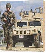 A U.s. Marine Guides A Humvee Wood Print