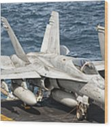 A Us Navy Fa-18c Hornet Tied Wood Print by Giovanni Colla
