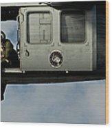 A U.s. Navy Naval Air Crewman Guides Wood Print
