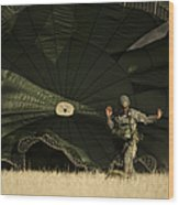 A U.s. Soldier Collapses His Parachute Wood Print