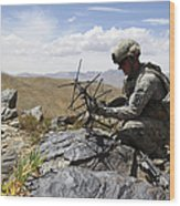 A U.s. Soldier Sets Up A Portable Wood Print