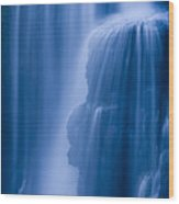 A Waterfall Splashes Off Of A Large Wood Print