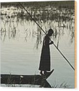 A Woman Stands At The End Of A Rowboat Wood Print by Lynn Abercrombie