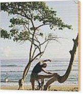 A Woman Stretches On A Beach Wood Print by Skip Brown