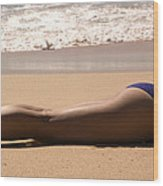 A Woman Sunbathes On The Beach Wood Print