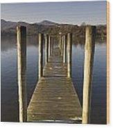 A Wooden Dock Going Into The Lake Wood Print