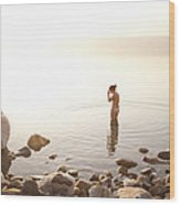 A Young Woman Wades Into The Dead Sea Wood Print