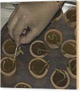 Adjusting The Wicks In A Plate Full Of Oil Lamps As Part Of Diwali Wood Print