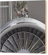 Airman Checks Components Atop A C-5 Wood Print