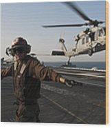 Airman Checks For A Clear Deck As An Wood Print