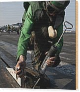 Airman Greases The Catapult Shuttle Wood Print