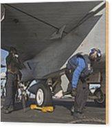 Airmen Chain Down An Fa-18e Super Wood Print
