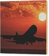 Airplane Landing At Sunset Wood Print