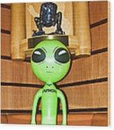 Alien In The Corner Booth Wood Print