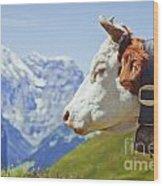 Alpine Cow Wood Print by Greg Stechishin