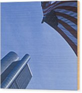 American Flag And Renaissance Center In Detroit, Michigan Wood Print by Will & Deni McIntyre