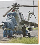 An Afghan Army Soldier Guards A Mi-35 Wood Print