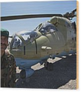 An Afghan Army Soldier Guards An Mi-35 Wood Print
