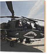 An Ah-64d Apache Helicopter Parked Wood Print
