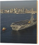 An Aircraft Carrier With The Skyline Wood Print