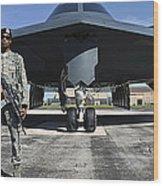 An Airman Guards A B-2 Spirit Wood Print