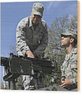 An Airman Instructs A Cadet On How Wood Print by Stocktrek Images