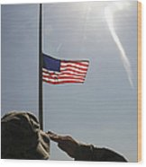 An Airman Salutes The American Flag Wood Print
