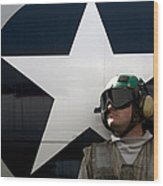 An Airman Stands In Front Of A C-2a Wood Print