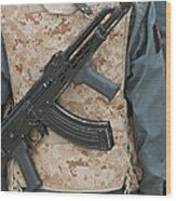 An Ak-47 Rests On The Sling Of An Wood Print