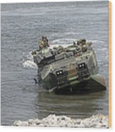 An Amphibious Assault Vehicle Climbs Wood Print