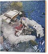 An Astronaut Is Submerged In The Water Wood Print by Stocktrek Images