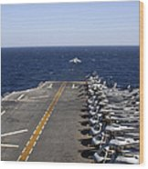 An Av-8b Takes Off From The Flight Deck Wood Print