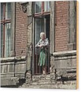 An Elderly Woman Stands At The Door Wood Print by Cotton Coulson