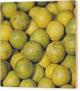 An Enticing Display Of Lemons Wood Print by Jason Edwards
