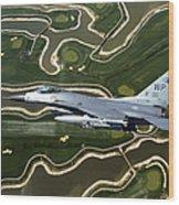 An F-16 Fighting Falcon Flies Near Base Wood Print