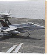An Fa-18a+ Hornet Lands Aboard Wood Print